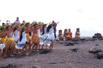 FILE - In this April 23, 2003 file photo, members of the Hula Na Mamo O Pu'uanahulu hula school perform a hula for Pele, the Hawaiin goddess of the volcano, on the rim of Kilauea Volcano in Hawai'i Volcanoes National Park in Hawaii. When residents of rural Hawaii neighborhoods where lava from Kilauea volcano has burned down or threatened to consume their homes, a name often comes up: Pele. Pele, known as the goddess of volcanoes and fire, is an important figure in Hawaiian culture. (AP Photo/David Jordan, File)