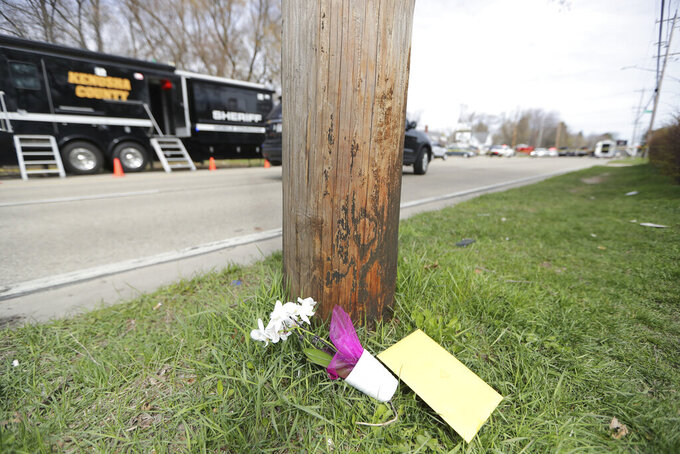 Flowers and a card are left near the scene of an early Sunday fatal shooting at Somers House Tavern in Kenosha, Wis., on Sunday, April 18 2021. (Mike De Sisti/Milwaukee Journal-Sentinel via AP)