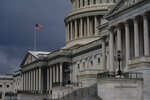 FILE - In this Aug. 3, 2020, file photo dark clouds and heavy rain sweep over the U.S. Capitol in Washington. At least a government shutdown is off the table. But as lawmakers straggle back to Washington for an abbreviated pre-election session, hopes are fading for a pandemic relief bill, or much else. (AP Photo/J. Scott Applewhite, File)