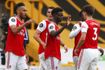 Arsenal's Bukayo Saka, center, celebrates after scoring the opening goal during the English Premier League soccer match between Wolverhampton Wanderers and Arsenal at the Molineux Stadium in Wolverhampton, England, Saturday, July 4, 2020. (Catherine Ivill/Pool via AP)