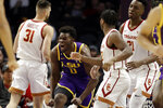 LSU forward Darius Days (0) celebrates after scoring against Southern California during the first half of an NCAA college basketball game Saturday, Dec. 21, 2019, in Los Angeles. (AP Photo/Marcio Jose Sanchez)