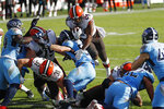 Cleveland Browns running back Nick Chubb (24) dives over the goal line to score a touchdown against the Tennessee Titans in the first half of an NFL football game Sunday, Dec. 6, 2020, in Nashville, Tenn. (AP Photo/Wade Payne)