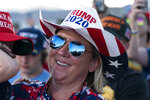 President Donald Trump is reflected in a supporter's sunglasses as he speaks at a campaign rally at Carson City Airport, Sunday, Oct. 18, 2020, in Carson City, Nev. (AP Photo/Alex Brandon)
