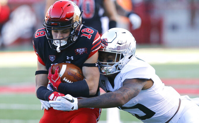 Oregon cornerback Deommodore Lenoir, right, tackles Utah wide receiver Britain Covey (18) in the first half during an NCAA college football game Saturday Nov. 10, 2018, in Salt Lake City. (AP Photo/Rick Bowmer)