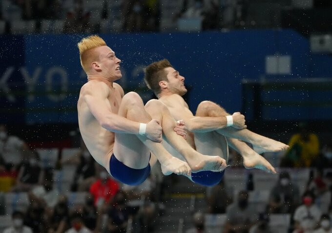 Andrew Capobianco and Michael Hixon of the United States' compete during the men's Synchronized 3m Springboard Final at the Tokyo Aquatics Centre at the 2020 Summer Olympics, Wednesday, July 28, 2021, in Tokyo, Japan. (AP Photo/Dmitri Lovetsky)