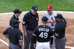 Umpire Joe West (22) talks with Chicago White Sox analytics coordinator Shelley Duncan (49) and St. Louis Cardinals manager Mike Shildt (8) as West's crew of Bruce Dreckman (1) Nic Lentz (59) and Dan Bellino listen before an interleague baseball game Monday, May 24, 2021, in Chicago. West now ties the major league record for games umpired. (AP Photo/Charles Rex Arbogast)