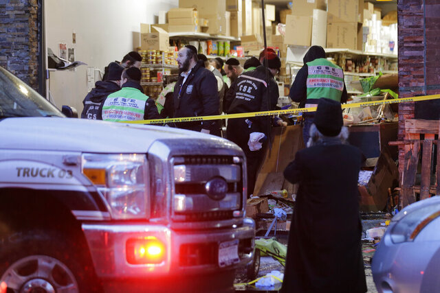 Emergency responders work at a kosher supermarket, the site of a shooting in Jersey City, N.J., Wednesday, Dec. 11, 2019. Jersey City Mayor Steven Fulop said authorities believe gunmen targeted the market during a shooting that killed multiple people Tuesday. (AP Photo/Seth Wenig)