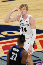 RETRANMISSION TO CORRECT TO SECOND HALF - Providence's Noah Horchler (14) gestures after making a three point basket during the second half of an NCAA college basketball game against DePaul in the Big East conference tournament Wednesday, March 10, 2021, in New York. (AP Photo/Frank Franklin II)