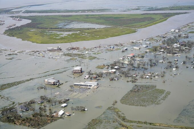 FILE - In this Aug. 27, 2020, file photo, buildings and homes are flooded in the aftermath of Hurricane Laura, near Lake Charles, La. (AP Photo/David J. Phillip, File)