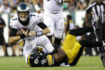 Philadelphia Eagles' Nate Sudfeld (7) is tackled by Pittsburgh Steelers' Jon Bostic (51) during the first half of a preseason NFL football game Thursday, Aug. 9, 2018, in Philadelphia. (AP Photo/Michael Perez)