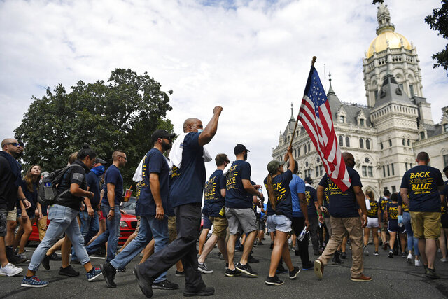 FILE — In this July 23, 2020, file photo, people participating in a