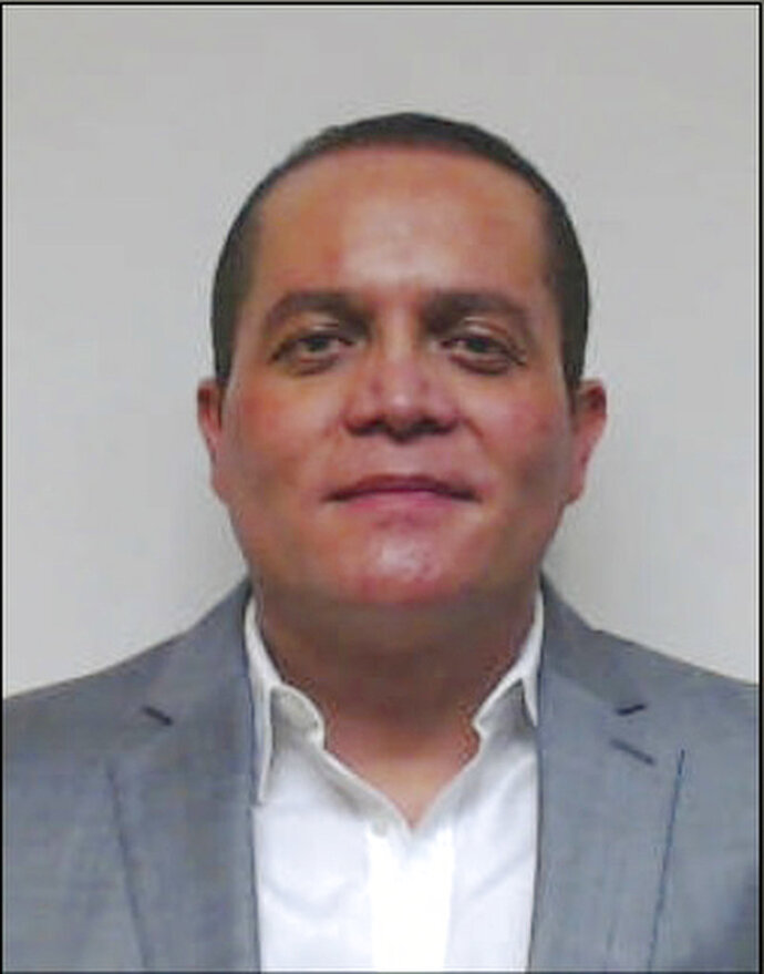 This undated photo provided by the U.S. Attorney's Office Central District of California shows Mexican fugitive Angel Humberto Chavez-Gastelum. Chavez-Gastelum and his son, Alonso Jaime Gastelum-Salazar, have been named in an indictment on Thursday, Sept. 13, 2018. They are charged with two counts of murder in Mexico. One of the victims was tortured and dismembered and the grisly act was shot on video obtained by investigators, prosecutors said. (U.S. Attorney's Office Central District Of California via AP)