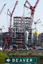 FILE - This April 18, 2019 file photo shows part of a petrochemical plant being built on the banks of the Ohio River in Monaca, Pa., for the Royal Dutch Shell company. The plant, which is capable of producing 1.6 million tons of raw plastic annually, is expected to begin operations by 2021. (AP Photo/Gene J. Puskar, File)