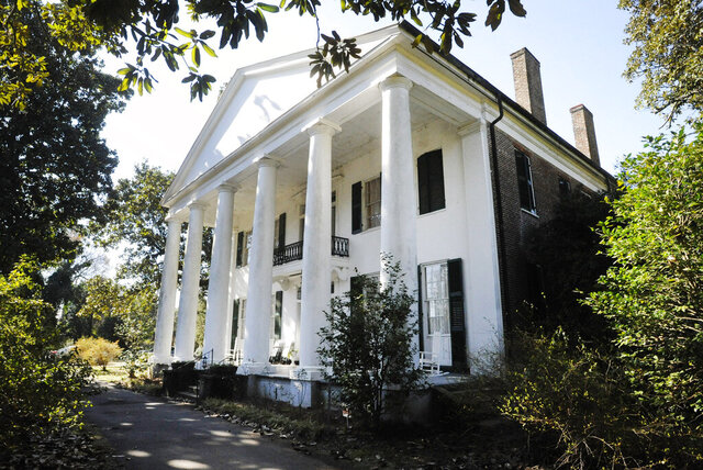 In this Jan. 30, 2020 photo, the Magnolia Grove, an antebellum plantation house in Greensboro, Ala., is seen. The home's entry in the National Register of Historic Places doesn't mention its ties to slavery even though visitors can see a display on enslaved people in an old slave dwelling. An Associated Press review found that many register entries for pre-Civil War plantations virtually ignore slavery. (AP Photo/Jay Reeves)