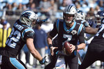 Carolina Panthers quarterback Kyle Allen (7) hands off to running back Christian McCaffrey (22) during the first half of an NFL football game against the Tennessee Titans in Charlotte, N.C., Sunday, Nov. 3, 2019. (AP Photo/Mike McCarn)