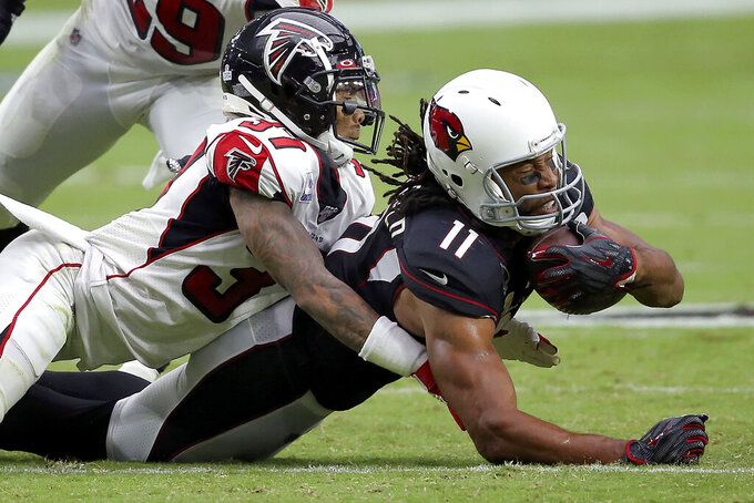 Arizona Cardinals wide receiver Larry Fitzgerald (11) is hit by Atlanta Falcons free safety Ricardo Allen (37) during the second half of an NFL football game, Sunday, Oct. 13, 2019, in Glendale, Ariz. (AP Photo/Ross D. Franklin)