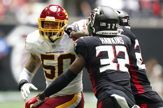 Washington Football Team linebacker Jared Norris (50) works against the Atlanta Falcons during the second half of an NFL football game, Sunday, Oct. 3, 2021, in Atlanta. (AP Photo/Brynn Anderson)