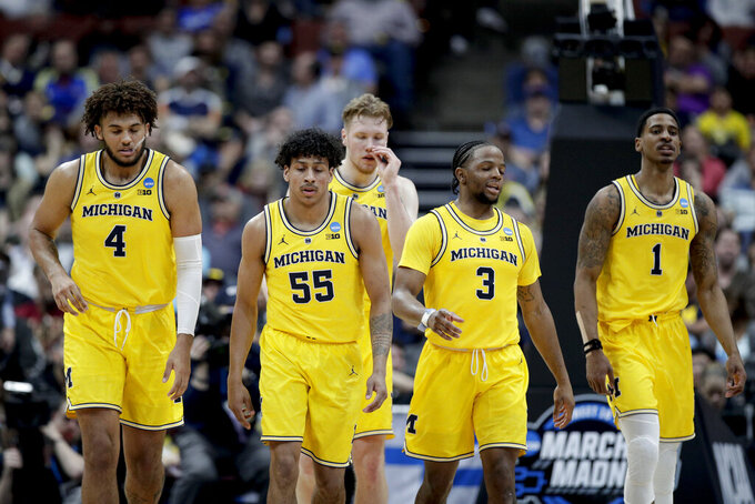 Michigan players walk to the bench during a timeout in the second half the team's NCAA men's college basketball tournament West Region semifinal against Texas Tech on Thursday, March 28, 2019, in Anaheim, Calif. (AP Photo/Jae C. Hong)