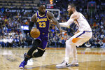Los Angeles Lakers forward LeBron James drives on Phoenix Suns center Aron Baynes (46) in the first half during an NBA basketball game, Tuesday, Nov. 12, 2019, in Phoenix. (AP Photo/Rick Scuteri)