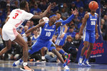 Memphis guard Damion Baugh (10) and Houston guard Dejon Jarreau (3) go for a loose ball in the second half of an NCAA college basketball game Saturday, Feb. 22, 2020, in Memphis, Tenn. (AP Photo/Karen Pulfer Focht)