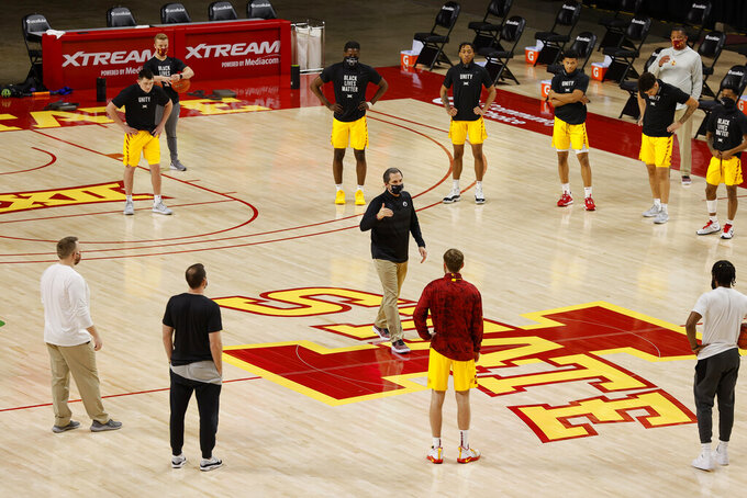 Iowa State head coach Steve Prohm, center, informs his team and staff that an NCAA college basketball game against DePaul has been canceled due to COVID-19 protocols inside the DePaul program, Sunday, Dec. 6, 2020, in Ames, Iowa. (AP Photo/Matthew Putney)