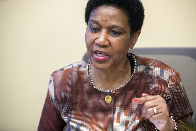 "FILE - In this Wednesday, March 7, 2018 file photo, Phumzile Mlambo-Ngcuka, United Nations Under-Secretary-General and Executive Director of U.N. Women, speaks during an interview with The Associated Press, in New York. The U.N. health agency and its partners have found in a new study released Tuesday, March 9, 2021 that nearly one in three women worldwide have experienced physical or sexual violence in their lifetimes, calling the results a ""horrifying picture"" that requires action by government and communities alike. Phumzile Mlambo-Ngcuka, executive director of UN Women, called violence against women ""the most widespread and persistent human rights violation that is not prosecuted."" (AP Photo/Mary Altaffer, file)"