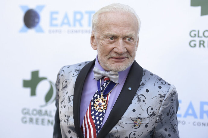 """FILE - In this Feb. 28, 2018 file photo, Buzz Aldrin attends the 15th annual Global Green Pre-Oscar Gala, at NeueHouse Hollywood in Los Angeles. Aldrin on Wednesday, Sept. 12 tweeted """"Goodnight Moon!"""" He wrote he's still """"thinking about you"""" and called his time on the lunar surface the """"best bouncy house ever.""""  The 88-year-old was the lunar module pilot when he and mission commander Neil Armstrong landed on the moon on July 21, 1969 during the Apollo 11 mission. (Photo by Richard Shotwell/Invision/AP, File)"""