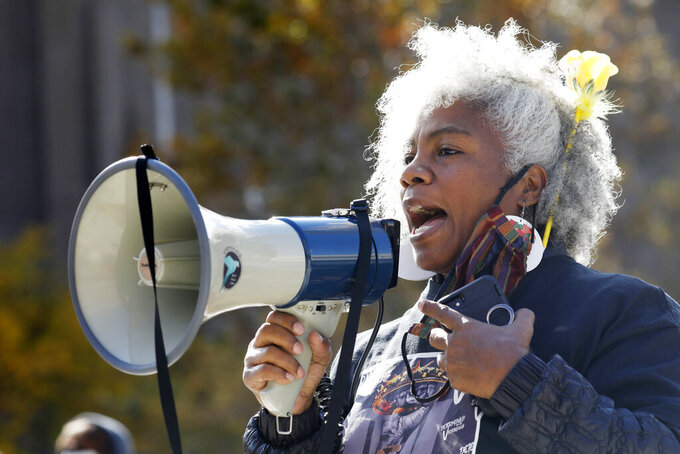 """Activist Cariol Horne speaks during the WNY Women's March hosted by the WNY Peace Center in Niagara Square, Saturday, Oct. 17, 2020 in Buffalo, N.Y. Horne, a Buffalo police officer who was fired for trying to stop another officer from using a chokehold on a handcuffed suspect, has won a years-long legal fight to collect her pension on Tuesday, April 13, 2021. A state Supreme Court judge cited the changing landscape around the use of force by police and a recently passed """"duty to intervene"""" statute adopted by the city. (Derek Gee/The Buffalo News via AP)"""