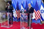 Israeli Prime Minister Benjamin Netanyahu and U.S. Defense Secretary Lloyd Austin prepare to deliver prepared remarks at his office, Monday, April 12, 2021, in Jerusalem. (Robert Burns)