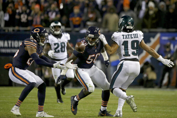 Chicago Bears inside linebacker Roquan Smith (58) breaks up a pass intended for Philadelphia Eagles wide receiver Golden Tate (19) as Bears defensive back Deon Bush (26) reaches for the ball during the second half of an NFL wild-card playoff football game Sunday, Jan. 6, 2019, in Chicago. (AP Photo/David Banks)