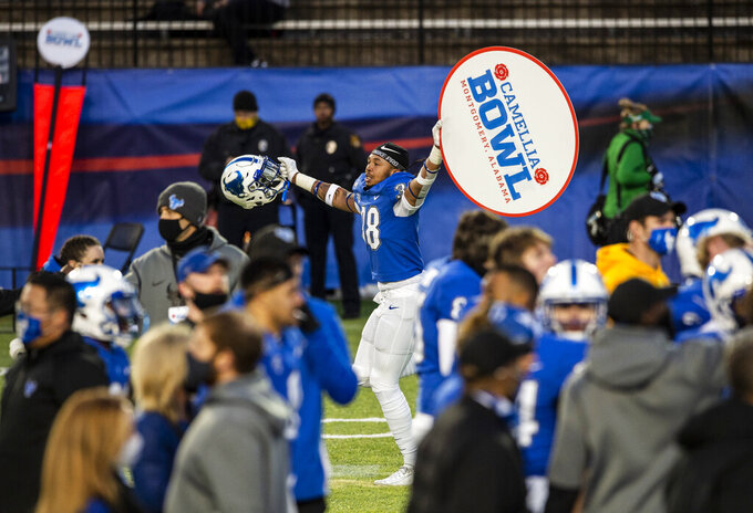Buffalo defensive end Bryce Johnson-Maith (38) celebrates after they defeated Marshall in the Camellia Bowl NCAA college football game Friday, Dec. 25, 2020, in Montgomery, Ala. (Jake Crandall/The Montgomery Advertiser via AP)