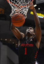 Houston's Chris Harris Jr. dunks during the first half of an NCAA college basketball game against Connecticut, Thursday, Feb. 14, 2019, in Hartford, Conn. (AP Photo/Jessica Hill)