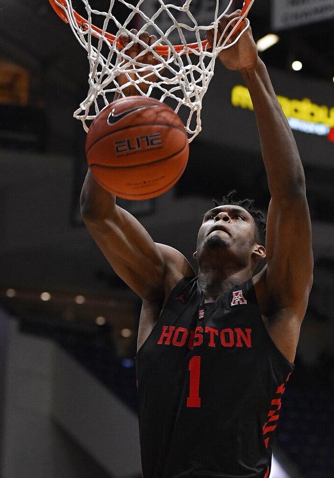 Houston's Chris Harris Jr. dunks during the first half of an NCAA college basketball game against Connecticut, Thursday, Feb. 14, 2019, in Hartford, Conn. (AP Photo/Jessica Hill)