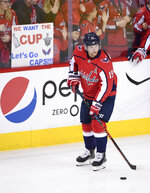 Washington Capitals center Nicklas Backstrom (19), of Sweden, skates with the puck before Game 4 of the team's NHL Eastern Conference finals hockey playoff series against the Tampa Bay Lightning, Thursday, May 17, 2018, in Washington. (AP Photo/Nick Wass)