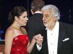 Opera star Placido Domingo holds the hand of Ana Maria Martinez at the end of a concert in Szeged, Hungary, Wednesday, Aug. 28, 2019. Domingo continued his calendar of European engagements unabated despite allegations of sexual harassment, appearing Wednesday at a concert in southern Hungary to inaugurate a sports complex for a local Catholic diocese.(AP Photo/Laszlo Balogh)