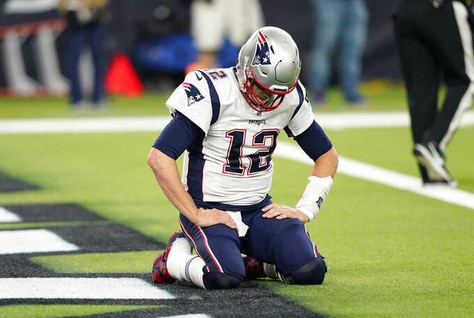 New England Patriots quarterback Tom Brady (12) kneels on the turn after a play during the second half of an NFL football game against the Houston Texans Sunday, Dec. 1, 2019, in Houston. (AP Photo/David J. Phillip)
