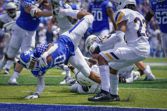 Kentucky running back Asim Rose (10) scores as touchdown during the first half of the NCAA college football game against Toledo, Saturday, Aug. 31, 2019, in Lexington, Ky. (AP Photo/Bryan Woolston)
