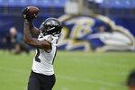 Baltimore Ravens wide receiver Rashod Bateman catches a pass during NFL football training camp Saturday, July 31, 2021, in Baltimore. (AP Photo/Gail Burton)