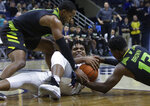 Connecticut's Josh Carlton, center, grapples for control of the ball with South Florida's LaQuincy Rideau, left, and Justin Brown, right, during the second half of an NCAA college basketball game, Sunday, March 3, 2019, in Storrs, Conn. (AP Photo/Steven Senne)