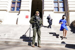 A Georgia State Patrol S.W.A.T. team member stands guard outside the Georgia State Capitol building Thursday, Jan. 14, 2021, in Atlanta. Governors in some states have called out the National Guard, declared states of emergency and closed their capitols over concerns about potentially violent protests. Though details remain murky, demonstrations are expected at state capitols beginning Sunday and leading up to President-elect Joe Biden's inauguration on Wednesday. (AP Photo/John Bazemore)