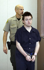 """In this Feb. 28, 2019, photo, Christopher W. Cleary, 27, makes a court appearance in Provo, Utah. Cleary's arrest for posting a Facebook threat to kill """"as many girls as I see"""" fit a pattern of behavior for a troubled man with a history of terrorizing women he met over the internet. Cleary's plea deal with Utah prosecutors fits a pattern of lenient punishments common for cyberstalking and online harassment cases. A judge who is scheduled to sentence Cleary on Thursday, May 23, must decide whether to accept prosecutors' recommended sentence of probation. (AP Photo/Rick Bowmer, Pool)"""