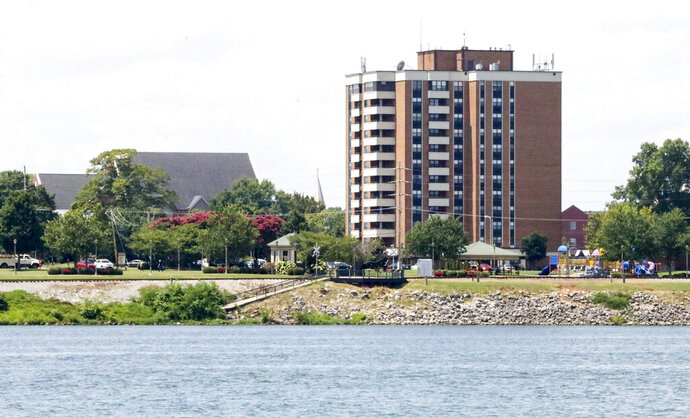 This Friday, Aug. 7, 2020 photo shows the Jordan-Neill Apartments, one of two riverfront Decatur Housing Authority properties for low-income elderly tenants. A federal review found that a public housing authority in Alabama let white people live in riverfront towers with scenic views and other amenities while segregating Black people in another apartment development without the frills, a newspaper reported. (Eric Fleischauer/The Decatur Daily via AP)