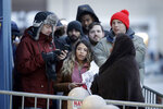 People wait in the cold outside a Best Buy store for it to open for a Black Friday sale Thursday, Nov. 28, 2019, in Overland Park, Kan. (AP Photo/Charlie Riedel)