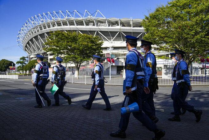 Police patrol outside the Ibaraki Kashima Stadium prior a men's quarterfinal soccer match between Japan and New Zealand at the 2020 Summer Olympics, Saturday, July 31, 2021, in Kashima, Japan, Tokyo. (AP Photo/Fernando Vergara)
