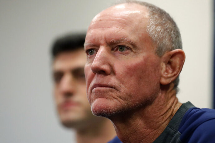Ron Roenicke, right, speaks as Red Sox Chief Baseball Officer Chaim Bloom looks on after being after being named interim of the Boston Red Sox baseball team Tuesday, Feb. 11, 2020, in Fort Myers, Fla. at left. (AP Photo/John Bazemore)
