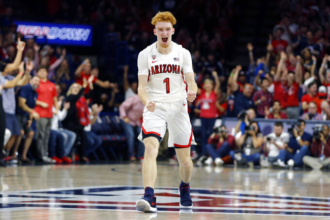Arizona guard Nico Mannion reacts after making a defensive stop against Illinois during the first half of an NCAA college basketball game Sunday, Nov. 10, 2019, in Tucson, Ariz. (AP Photo/Rick Scuteri)