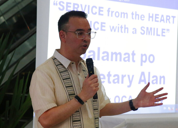 Outgoing Philippine Foreign Affairs Secretary Alan Peter Cayetano talks to the media as he bids farewell to his staff during the lowering of the flag ceremony Friday, Oct. 12, 2018 in suburban Pasay city south of Manila, Philippines. Cayetano, who resigned this week to run for a seat in the Philippine Congress for next year's mid-term elections, confirmed in a news conference Friday that President Rodrigo Duterte and Vietnamese Prime Minister Nguyen Xuan Phuc, in a meeting in Indonesia, discussed efforts by their countries to delineate their maritime boundaries in the disputed South China Sea, most of which is claimed by China. (AP Photo/Bullit Marquez)