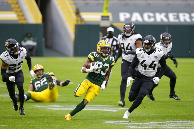 Green Bay Packers' Aaron Jones runs during the second half of an NFL football game against the Jacksonville Jaguars Sunday, Nov. 15, 2020, in Green Bay, Wis. The Packers won 24-20. (AP Photo/Mike Roemer)
