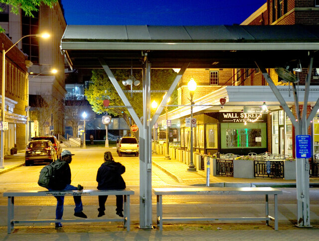 People look over the empty streets of downtown Roanoke from Market Square on Monday night, March 30, 2020.. (Heather Rousseau/The Roanoke Times via AP)