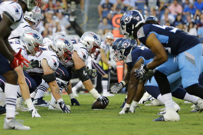 New England Patriots center Ted Karras (75) prepares to snap the ball against the Tennessee Titans in the second half of a preseason NFL football game Saturday, Aug. 17, 2019, in Nashville, Tenn. (AP Photo/James Kenney)